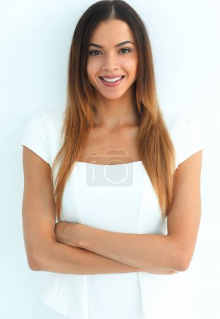 Photo for Woman crossed arms standing against white. Confident pose - Royalty Free Image