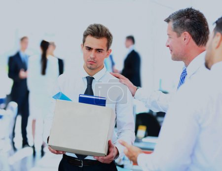 dismissed businessman carrying box.