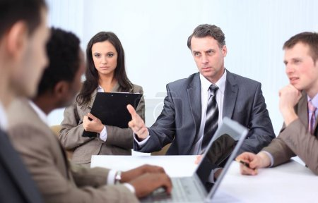 businessman holds working meeting with employees