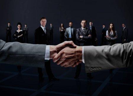 Handshake isolated on business background...
