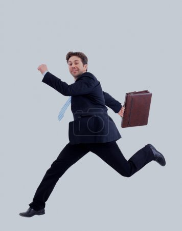Isolated attractive business man running away from someone.