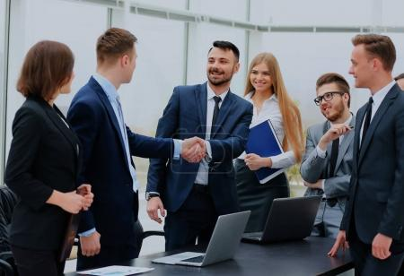 Two professional business people shaking hands.