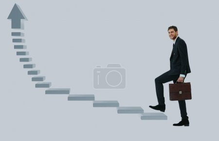 Businessman up the staircase over white background. ready for your design.