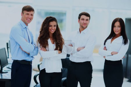 Photo for Group of businesspeople standing together in office - Royalty Free Image