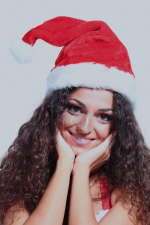 Beautiful happy woman in Santa Claus clothes.