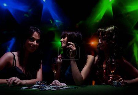 young girls on disco in night club.