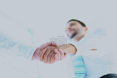 Low angle-shot of shake hands.