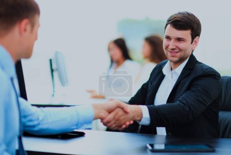The salesman shaking hands with customers.