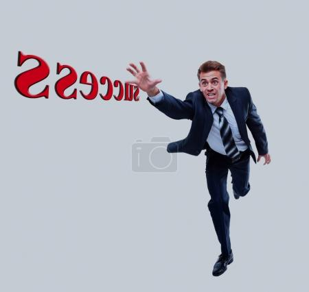Happy running businessman. Isolated on white background.