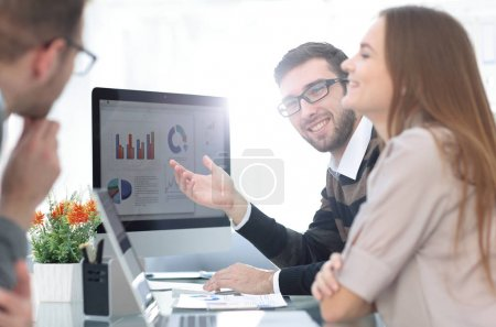 business team discussing financial charts