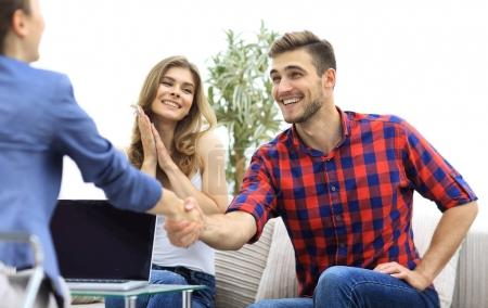 woman psychologist welcomes the client before beginning the session