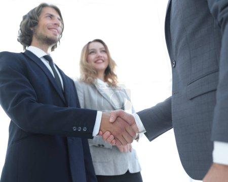 Photo of handshake of two happy businessmen