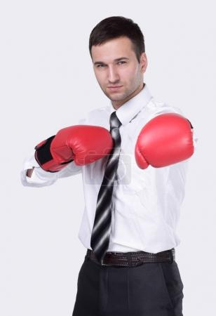 Competitive businessman in boxing gloves.