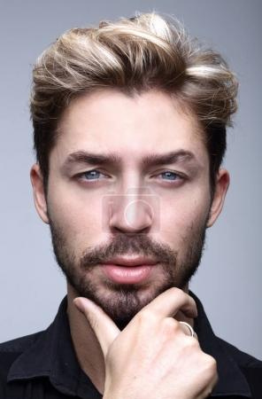 thoughtful businessman holding his hand under his chin