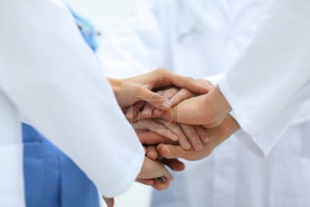closeup.Small group of doctor team joining hands,