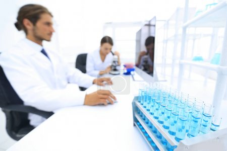 side view of scientists working in laboratory