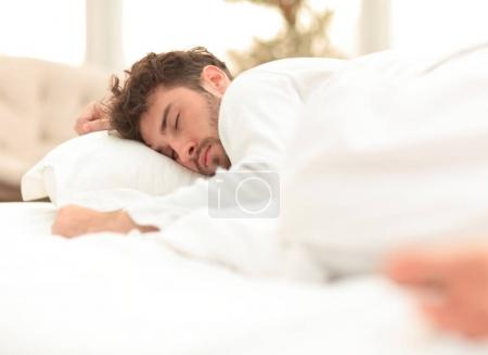 Photo for Closeup.the tired men sleep soundly on the bed .photo with copy space - Royalty Free Image