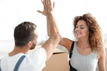 Happy and young couple giving a high five