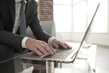 Portrait of successful businessman working in modern office