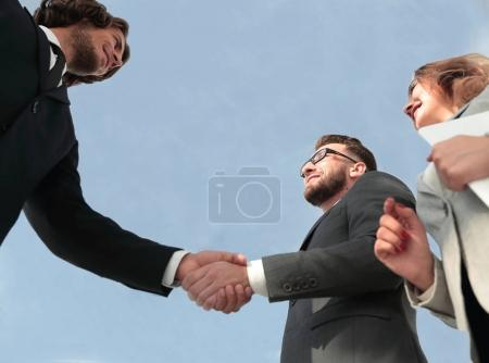 Photo for Close-up shot of businessmen shaking hands in the office - Royalty Free Image