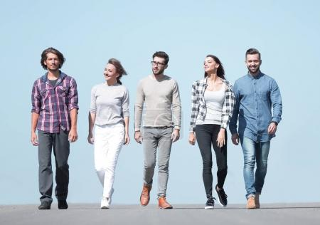 Photo for In full growth.a group of young people walking along the road.photo with copy space - Royalty Free Image