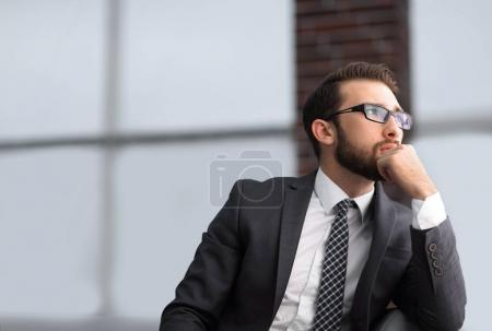 Photo for Pensive Business Man Sitting in Office Lounge - Royalty Free Image