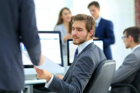 businessman working on a computer on business reports