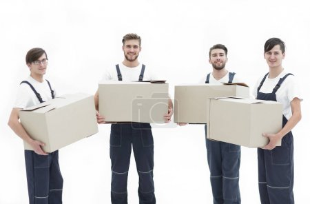Photo for Young movers holding boxes. Delivering and transportation concept. - Royalty Free Image
