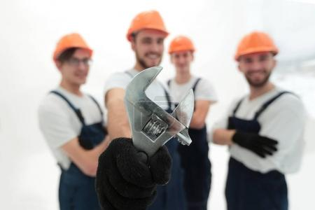 closeup. the wrench in the hands of the builders