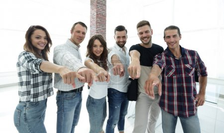 members of the business team pointing his arms forward.