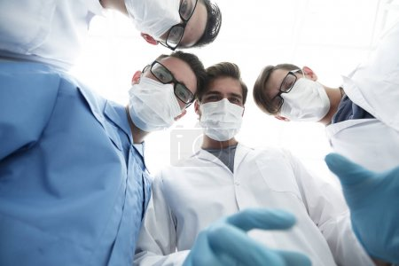 Photo for Closeup. a group of doctors in the operating room .the concept of health. - Royalty Free Image