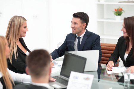 group of business people discussing a new financial project