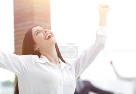 happy young business woman on a blurred office background.
