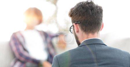 Lawyer advises his client. back view. concept of c...