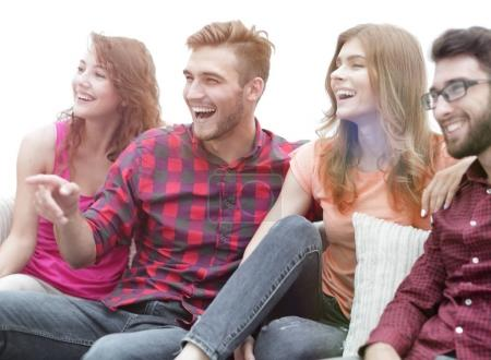 Photo for Friends are watching your favorite show sitting on the couch. photo with copy space - Royalty Free Image