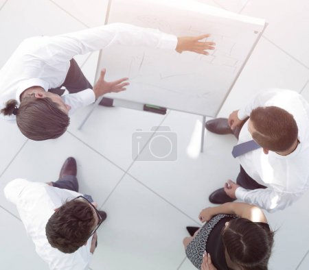 Photo for View from the top. background image of a business team discussing new ideas, standing in office hall. - Royalty Free Image