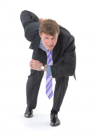 A young handsome businessman, dressed in a suit, began to run