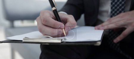Photo for Closeup of human hand writing on a paper. - Royalty Free Image