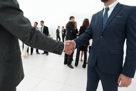 Photo for Business concept.closeup of handshake of business partners on the background of business team - Royalty Free Image