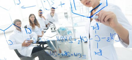 Photo for View through the transparent Board. female biochemist analyzing information.concept of research - Royalty Free Image