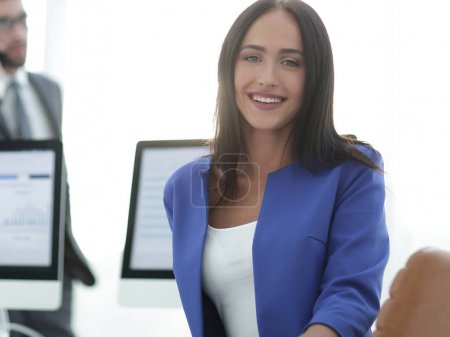 Young brunette businesswoman  girl looking at camera