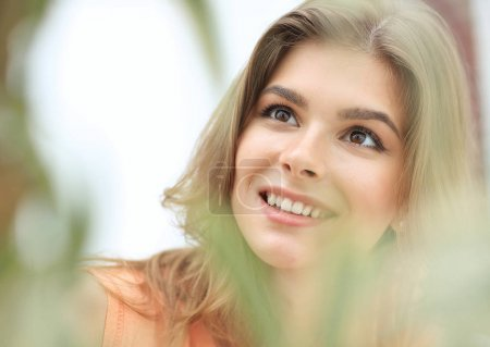 portrait of smiling woman face on blurred background.