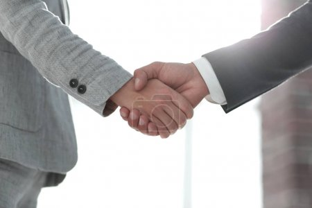 Business people shaking hands isolated on white background