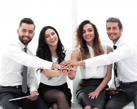 Photo for Successful business team showing their unity - Royalty Free Image