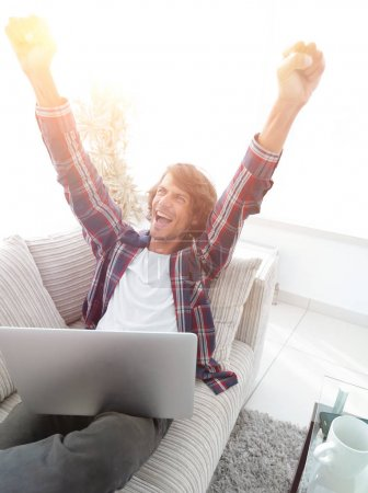 Photo for Very happy guy working with laptop at home. photo with copy space - Royalty Free Image