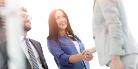 Photo for Business woman smiling and doing a handshake in the office - Royalty Free Image