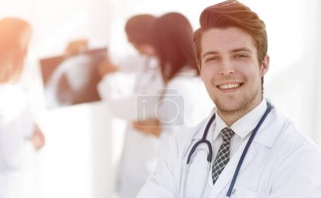 young doctor on the background of colleagues