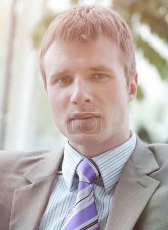 Close up portrait of young handsome serious business man