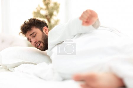Photo for Closeup.tired men asleep on the bed .photo with copy space - Royalty Free Image