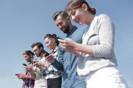 young people using smartphones to search network